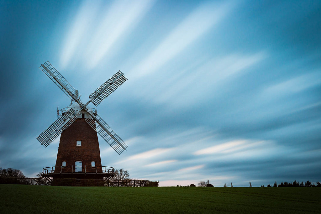 windmill against racing clouds