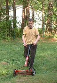 the author mowing the yard